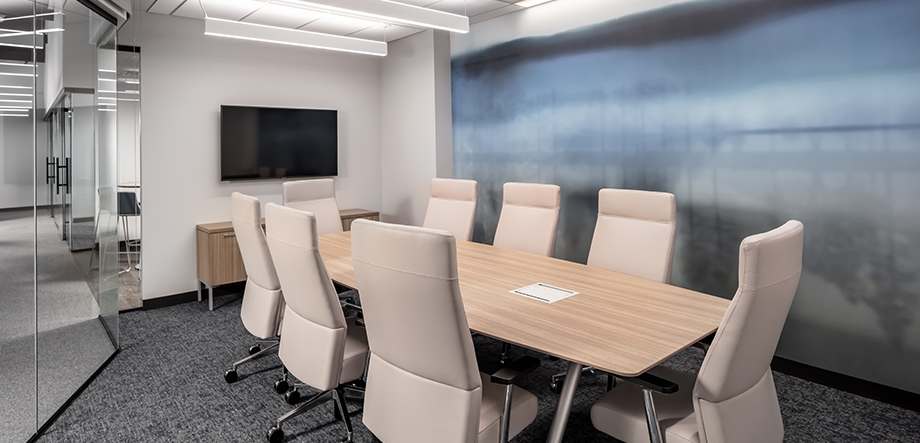 Built. Conference Room With 8 Beige Chairs Around a Long Table